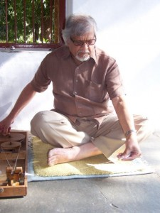 Arun Gandhi spinning cloth at Sabarmati Ashram, Ahmedabad, India — at Ahmedabad.